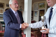 Jim Bicker presenting Tommy Wilkinson with Trophy